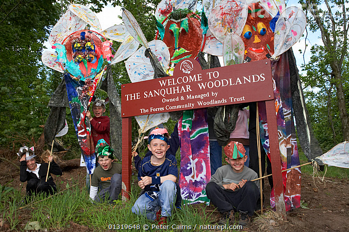 Children with woodland art celebrating anniversary event. Part of Enchanted Woodland Event at Sanquhar Woods (Forres Community Woodland Trust), Scotland, May 2007.  ,  ART,CELEBRATIONS,CHILDREN,CRAFTS,EDUCATION,EUROPE,LEARNING,OUTDOORS,PAINTING,PEOPLE,SCOTLAND,TREES,UK,YOUNG,PLANTS,United Kingdom  ,  Peter Cairns