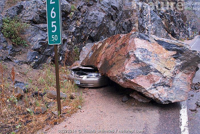Heavy rain causes a sixty ton rock to fall on a car on the Colorado Front Range, USA, July 2005  ,  CAR,CRUSHED,DAMAGE,DANGER,DESTRUCTION,FALLEN,GRIFT,HAZARD,JON,LANDSCAPES,MISFORTUNE,OBJECTS,OUTDOORS,ROAD,ROCK,SLIDE,TRANSPORTATION,TWO,USA,VAN,WEATHER,North America  ,  Visuals Unlimited