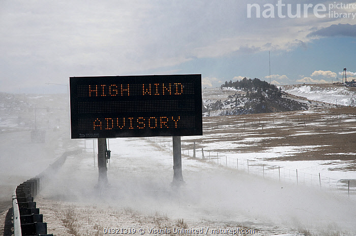 With winds gusting to over 70mph, a sign warns motorists of a high wind advisory along the foothills of the Colorado Front Range, USA, February 2008  ,  ADVISORY,COLORADO,DANGER,GRAY,HIGHWAY,LANDSCAPES,OBJECT,OUTDOORS,RANGE,SIGN,SINGLE,SKY,STORMY,THREATENING,USA,WARNING,WEATHER,WIND,North America  ,  Visuals Unlimited