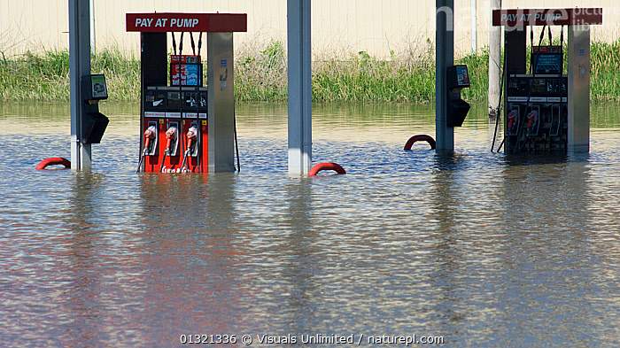 Floodwaters from the Mississippi River submerge gasoline pumps in Fort Madison, Iowa during the historic 2008 flood., USA, June 2008  ,  CONTAMINATION,DAMAGE,DESTRUCTION,DISASTER,EMERGENCY,ENVIRONMENTAL,FLOOD,FLOODS,GAS,GASOLINE,GEOLOGY,IOWA,ISSUE,LANDSCAPES,MISSISSIPPI,NATURAL,OBJECTS,OIL,OUTDOORS,POLLUTION,PUMP,RIVER,STATION,TWO,USA,WEATHER,North America  ,  Visuals Unlimited
