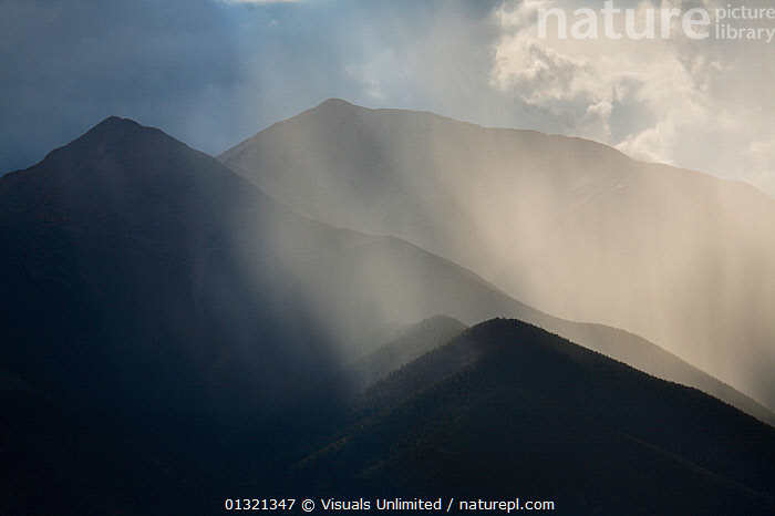 Mt. Antero (14,269 ft-4349 m) is silhouetted in the late afternoon as a rainstorm crosses its flanks, Colorado, USA. August 2007  ,  ANTERO,COLOR,COLORADO,FOGGY,LANDSCAPES,MISTY,MOUNTAIN,MOUNTAINS,MT,OUTDOORS,RAIN,ROCKY,SILHOUETTE,STORM,USA,Weather,North America  ,  Visuals Unlimited
