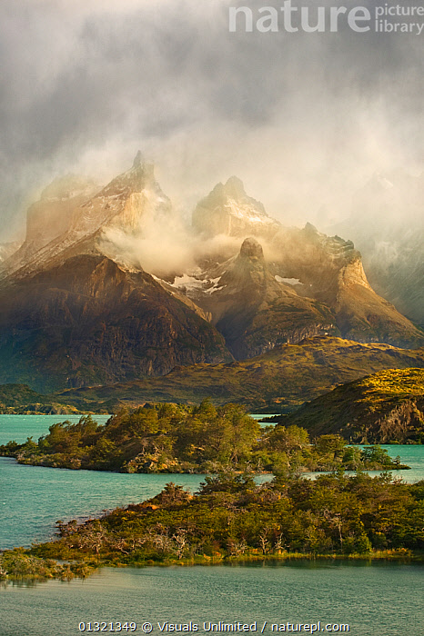 A morning rainstorm moves across the Cuernos del Paine in Torres del Paine National Park, Patagonia, Chile. February 2010  ,  ALPINE,BEAUTY,CHILE,CLOUDY,COLOR,DON,FOREST,GEOLOGY,GRALL,LAKE,LANDSCAPE,LANDSCAPES,MOUNTAIN,NATIONAL,OUTDOORS,PAINE,PARK,PATAGONIA,RAINSTORM,SOUTH AMERICA,TORRES,VERTICAL,SOUTH-AMERICA  ,  Visuals Unlimited