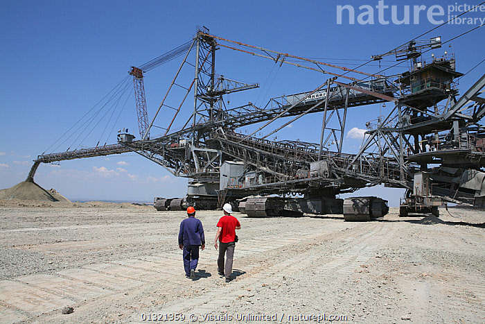 Workers approaching a huge coal excavator. Maritsa Iztok is the largest Coal mine in Bulgaria. Many large excavators, up to 70 meter high, work day and night. The coal provides 85% of the country's energy. September 2008  ,  BACK,BULGARIA,COAL,COLOR,ENERGY,EXCAVATOR,FOSSIL,FUEL,GIGANTIC,INDUSTRY,IZTOK,LANDSCAPES,MACHINE,MAN,MARITSA,MATURE,MINE,MINERAL,MINING,NATURAL,OPEN PIT,OUTDOORS,PEOPLE,RADNEVO,RESOURCE,SURFACE,TWO,UNRECOGNIZABLE,WORKER  ,  Visuals Unlimited
