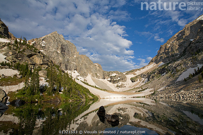 Alpine tarn and glacial horn in the Teton Range, Wyoming, USA. July 2008, Note the U-shaped profile of the top of the cirque.  ,  ALPINE,CIRQUE,DESTINATION,EROSION,GEOLOGY,GLACIAL,GRAND,HORN,LAKE,LANDSCAPE,LANDSCAPES,MOUNTAIN,MOUNTAINS,MT.,NATIONAL,OUTDOORS,PARK,REFLECTION,ROCKY,RUGGED,SCENIC,SERENE,TAMINAH,TARN,TETON,TRAVEL,USA,U SHAPED,VALLEY,WISTER,WYOMING,North America ,Rocky Mountains,  ,  Visuals Unlimited