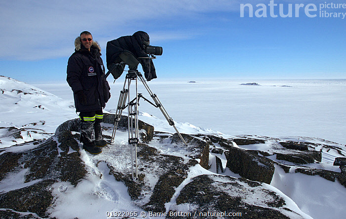 """Cameraman Barrie Britton filming in the Belcher Islands, Hudson Bay, Canada. Picture taken during filming for BBC """"Planet Earth"""" TV Series, March 2006.  ,  camera,CANADA,FILMING,ISLANDS,LANDSCAPES,MEN,NORTH AMERICA,PEOPLE,PORTRAITS,SNOW,WORKING  ,  Barrie Britton"""