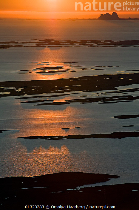 The view of the Helgeland Archipelago, including Donna and Taena, from the top of Donnamannen, in the midnight sun, Helgeland, Nordland, Norway, July 2009  ,  ARCTIC,COASTS,EUROPE,LANDSCAPES,NIGHT,NORWAY,SCANDINAVIA,SUN,VERTICAL  ,  Orsolya Haarberg