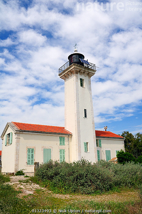 Gacholle lighthouse at the heart of the Camargue National Reserve, France, May 2010.  ,  BUILDINGS,CLOUDS,EUROPE,FRANCE,LANDSCAPES,LIGHTHOUSES,RESERVE,VERTICAL,Weather,core collection xtwox  ,  Nick Upton