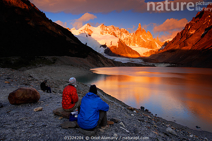 Mountaineers watching the sunrise over Cerro Torre (3102 m), Los Glaciares National Park, Andes, Patagonia, Argentina, January 2006  ,  ARGENTINA,DRAMATIC,GLACIERS,HIKER,HIKING,LAKES,LANDSCAPES,LEISURE,MOUNTAINEERING,MOUNTAINS,NP,PEACEFUL,PEOPLE,REFLECTIONS,RESERVE,SOUTH AMERICA,SUNRISE,TWO,WATER,Geology,SPORTS,National Park,Concepts  ,  Oriol Alamany