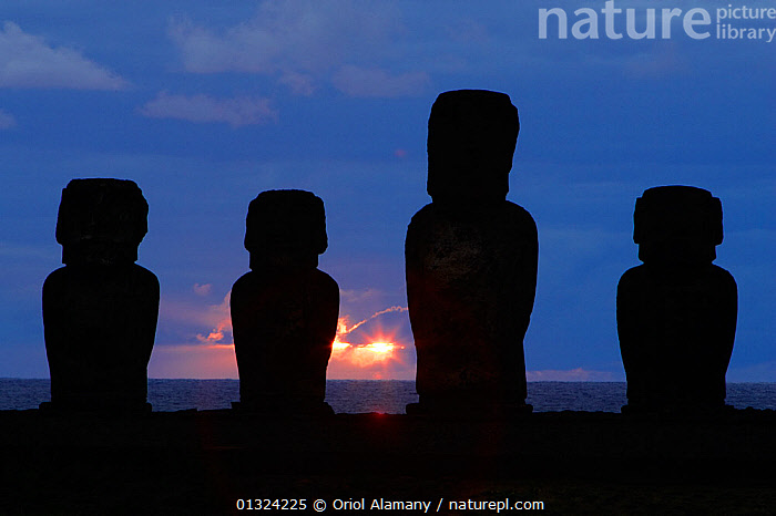 Giant moai statues stand erect at sunrise in Ahu Tongariki, Easter Island (Pascua or Rapa Nui),  Unesco World Heritage Site, November 2004  ,  ANCIENT,ARTIFACTS,CULTURES,DAWN,FOUR,LANDSCAPES,OCEANIA,PACIFIC ISLANDS,POLYNESIA,RESERVE,SCULPTURE,SILHOUETTES,STATUE,STATUES,STONE,SUNRISE,core collection xtwox  ,  Oriol Alamany
