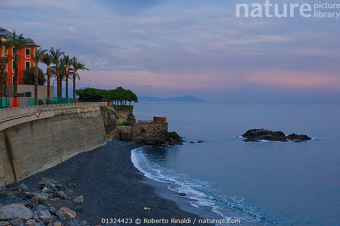 """View out to sea at the wreck site of crude oil super-tanker """"Amoco Milford Haven"""", which sank on April 14th, 1991 after three days of fire. Genoa, Italy, August 2007.  ,  BEACHES,BUILDINGS,COASTS,DAWN,DUSK,EUROPE,ITALY,LANDSCAPES,MEDITERRANEAN,PALMS,ROCKS,TOWNS,core collection xtwox  ,  Roberto Rinaldi"""
