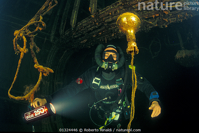 """Lamp inside engine room of wrecked crude oil super-tanker Amoco """"Milford Haven"""", which sank on April 14th, 1991 after three days of fire. Genoa, Italy, 2002.  ,  BOATS,DIVING,EUROPE,HISTORICAL,ITALY,LIGHTS,MARINE,MEDITERRANEAN,OIL TANKERS,PEOPLE,TANKERS,TEMPERATE,UNDERWATER,WRECKS,WORKING-BOATS  ,  Roberto Rinaldi"""