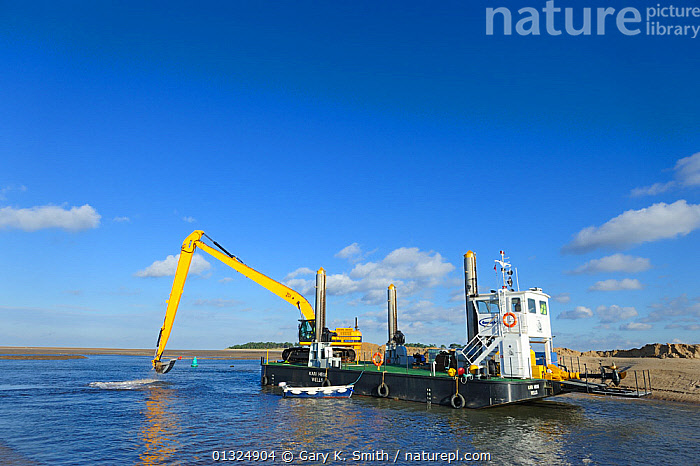 Dredging in tidal channel, Wells-next-the-sea Norfolk, UK, November 2010  ,  BOATS,COASTS,DREDGERS,ENGLAND,EUROPE,LANDSCAPES,MACHINES,UK,WATER,WORKING BOATS,WORKING-BOATS ,United Kingdom  ,  Gary K. Smith