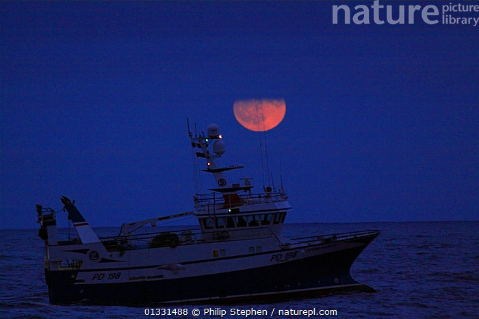 "Moon rising over fishing vessel ""Ocean Harvest"" on the North Sea. Europe, January 2011. Property released.  ,  BLUE,BOATS,EUROPE,FISHING BOATS,MOON,NIGHT,NORTH SEA,PROFILE,TRAWLERS,WORKING BOATS  ,  Philip Stephen"