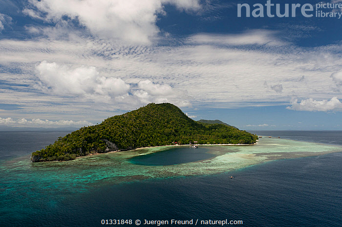 Aerial view of Kri Island and Sorido Bay Resort. Raja Ampat, West Papua, Indonesia, February 2010  ,  AERIALS,ASIA,BEACHES,CLOUDS,COASTAL WATERS,COASTS,coral triangle,INDONESIA,INDO PACIFIC,Irian Jaya,ISLANDS,lagoons,LANDSCAPES,SKY,SOUTH EAST ASIA,TROPICAL,,Weather,SOUTH-EAST-ASIA,NEW-GUINEA  ,  Jurgen Freund