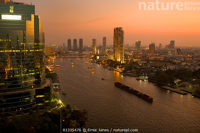 Bangkok City Centre and River Chao Phraya at dusk, Thailand, ASIA,bangkok,BOATS,BRIDGES,building exterior,BUILDINGS,catalogue4,CITIES,city,city centre,cityscape,DUSK,elevated view,Evening,high rise building,INDUSTRY,LANDSCAPES,LIGHTS,lit up,MIXED BOATS,NIGHT,Nobody,river,River Chao Phraya,RIVERS,skyscrapers,THAILAND,travel destination,URBAN,SOUTH-EAST-ASIA, Ernie Janes