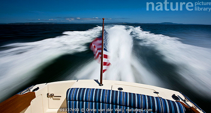 Hinckley T38 speedboat cruising off Rhode Island, USA, August 2008. All non-editorial uses must be cleared individually.  ,  ABOARD,BOATS,CRUISING,ENSIGNS,FREEDOM,MOTORBOATS,NORTH AMERICA,PLANING,SPEED,SPEEDBOATS,STERNS,WAKE,CONCEPTS,BOAT-PARTS  ,  Onne van der Wal