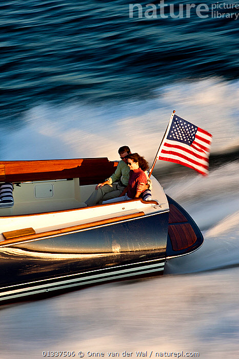 Couple on board Hinckley T38 speedboat travelling at speed. Rhode Island, USA, August 2008. All non-editorial uses must be cleared individually.  ,  BOATS,COUPLES,CRUISING,ENSIGNS,LEISURE,LIFESTYLE,MAN,MOTORBOATS,MS,NORTH AMERICA,PEOPLE,PLANING,SPEED,SPEEDBOATS,SPRAY,STERNS,VERTICAL,WAKE,WOMAN,BOAT-PARTS  ,  Onne van der Wal