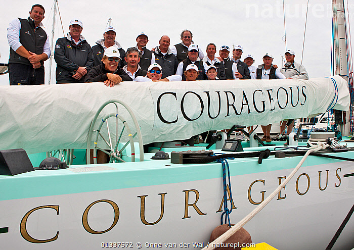"""Portrait of crew on board """"Courageous"""" during the 12 Metre North American Championships. Newport, Rhode Island, USA, September 2010. All non-editorial uses must be cleared individually.  ,  12 METRES,BOATS,CREWS,GROUPS,MS,NAMES,NORTH AMERICA,PORTRAITS,RACES,SAILING BOATS,SMILING,TEXT,USA,YACHTS,SAILING-BOATS  ,  Onne van der Wal"""