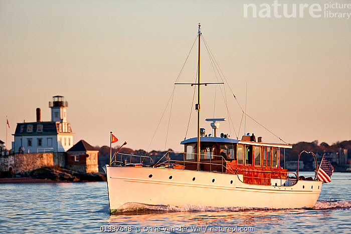 "Restored classic powerboat ""Carina"" off the coast of Newport, Rhode Island, USA, November 2010. All non-editorial uses must be cleared individually.  ,  BOATS,BUILDINGS,CLASSICS,COASTS,CRUISING,LIGHTHOUSES,MOTORBOATS,NORTH AMERICA,PROFILE,TOWNS,USA  ,  Onne van der Wal"