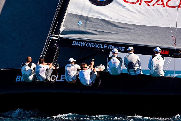 Crew hiking-out on board yacht during a race in the RC44 Circuit in Miami. Florida, USA, December 2010. All non-editorial uses must be cleared individually.  ,  BOATS,CREWS,HEELING,HIKING OUT,MS,NORTH AMERICA,PEOPLE,PROFILE,RACES,SAILING BOATS,USA,YACHTS,core collection xtwox  ,  Onne van der Wal