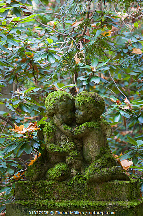 Moss covered statue of angels on the grave of a child, Sydwestkirchhof Stahnsdorf, Berlin, Germany. November 2009  ,  CHURCHYARD,EUROPE,GERMANY,GRAVES,MOSS,PLANTS,STATUES,VERTICAL  ,  Florian Möllers