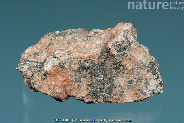 Pegmatite is a very coarse grained plutonic igneous rock with a similar composition to granite.  ,  BLUE,CLOSE,GEOLOGY,IGNEOUS,OBJECT,PEGMATITE,PLUTONIC,ROCK,ROCKS,SHOT,SINGLE,STUDIO  ,  Visuals Unlimited