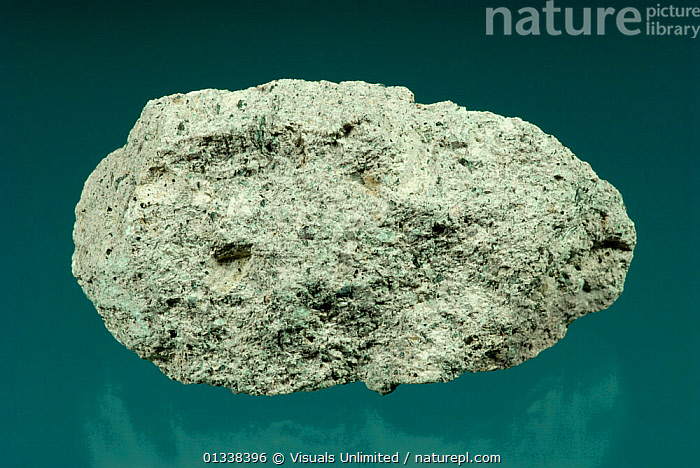Tuff is a volcanic igneous rock made of compacted volcanic materials smaller than 4mm in size.  ,  BLUE,CLOSE,GEOLOGY,GRAY,IGNEOUS,OBJECT,ROCK,ROCKS,SHOT,SINGLE,STUDIO,TUFF  ,  Visuals Unlimited