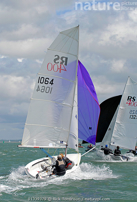 Boats racing under spinnaker during the RS400 Gull Grand Prix. Thorness Bay, Isle of Wight, England, May 2011.  ,  BOATS,DINGHIES,ENGLAND,EUROPE,GULLS,MAINSAILS,NUMBERS,RACES,RACING,REAR VIEWS,SAILING BOATS,SAILS,SPINNAKERS,UK,VERTICAL,SAILING-BOATS ,United Kingdom,core collection xtwox  ,  Rick Tomlinson