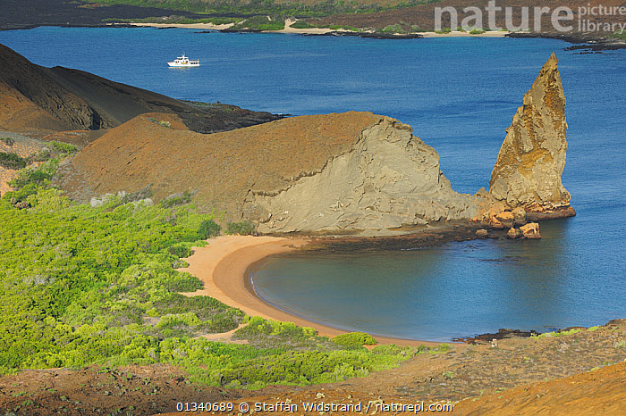 An inlet and beach on Bartholomew Island with a boat in the background. Galapagos, Ecuador, April 2010., BEACHES,BOATS,COASTS,CRUISING,ECUADOR,GALAPAGOS,LANDSCAPES,MARINE,MOTORBOATS,PACIFIC ISLANDS,SOUTH AMERICA,WATER,SOUTH-AMERICA, Staffan Widstrand