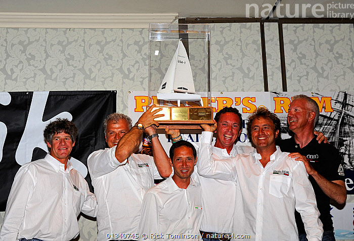 """""""UkaUka Racing"""" team collecting trophy after winning the Melges 24 World Championships. Corpus Christi, Texas, USA, May 2011., AWARDS,CELEBRATIONS,CREWS,INTERIORS,NORTH AMERICA,PEOPLE,PORTRAITS,RACES,TEAMS,TROPHIES,USA,WINNERS, Rick Tomlinson"""
