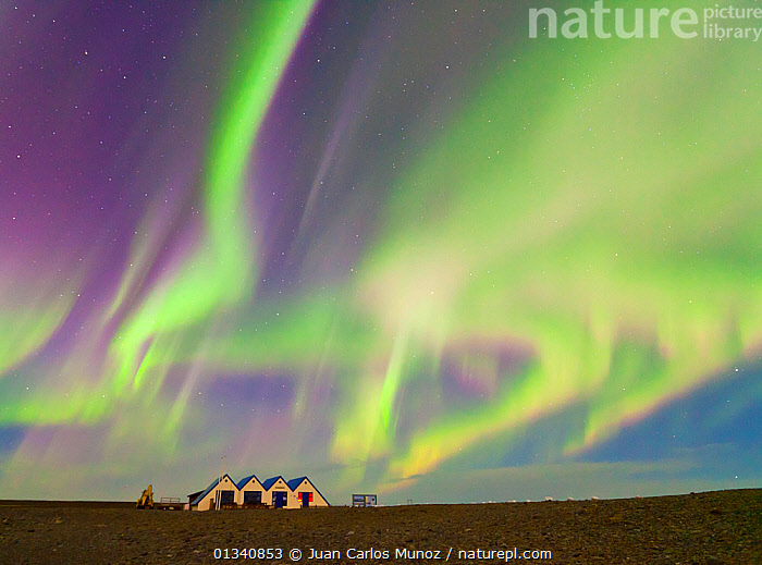 Northern lights (Aurora Borealis) in sky above buildings by Jokulsarlon glacier lagoon. Southern Iceland, Europe, March 2011., ARCTIC,ARTY SHOTS,AURORA,BEAUTY IN NATURE,BOREAL,BUILDINGS,EUROPE,GREEN,ICELAND,LANDSCAPES,LIGHTS,NIGHT,SKIES,core collection xtwox, Juan Carlos Munoz