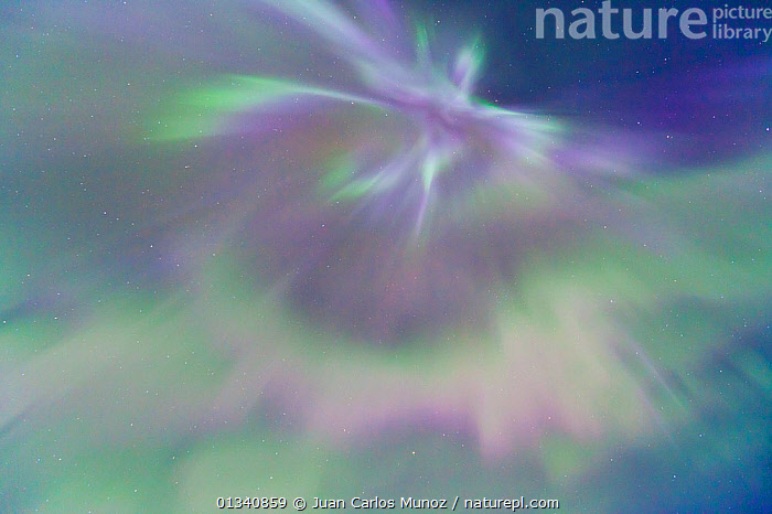 Looking up into the northern lights (Aurora Borealis) in sky Jokulsarlon glacier lagoon, Southern Iceland, Europe, March 2011., ABSTRACT,ARCTIC,ARTY SHOTS,AURORA,BACKGROUNDS,BEAUTY IN NATURE,BOREAL,COLOURFUL,EUROPE,ICELAND,LIGHTS,NIGHT,PATTERNS,SKIES, Juan Carlos Munoz