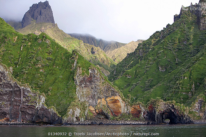 Dramatic geology with caves sheer mountain peak. Quest Bay, Gough Island, South Atlantic Islands, March 2007., ATLANTIC ISLANDS,CLIFFS,COASTS,GEOLOGY,LANDSCAPES,MOUNTAINS,SEASCAPES, Troels Jacobsen/Arcticphoto