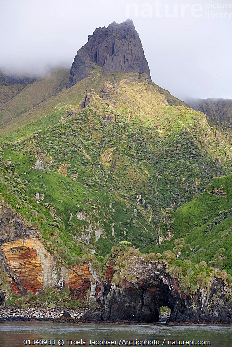 Dramatic geology with caves sheer mountain peak. Quest Bay, Gough Island, South Atlantic Islands, March 2007., ATLANTIC ISLANDS,CLIFFS,COASTS,LANDSCAPES,MOUNTAINS,SEASCAPES,VERTICAL,Geology, Troels Jacobsen/Arcticphoto