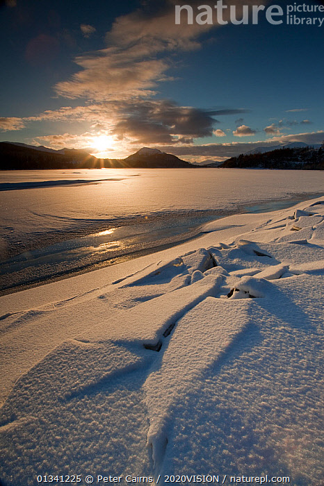 Sunset over Loch Laggan with snow and ice, Creag Meagaidh NNR, Highland, Scotland, UK, December 2010, 2020VISION,ATMOSPHERIC,EUROPE,ICE,LAKES,LANDSCAPES,MOUNTAINS,PCA_3_0161210_22,RESERVE,SCOTLAND,SNOW,SUN,SUNSET,UK,VERTICAL,WINTER,United Kingdom, Peter Cairns / 2020VISION