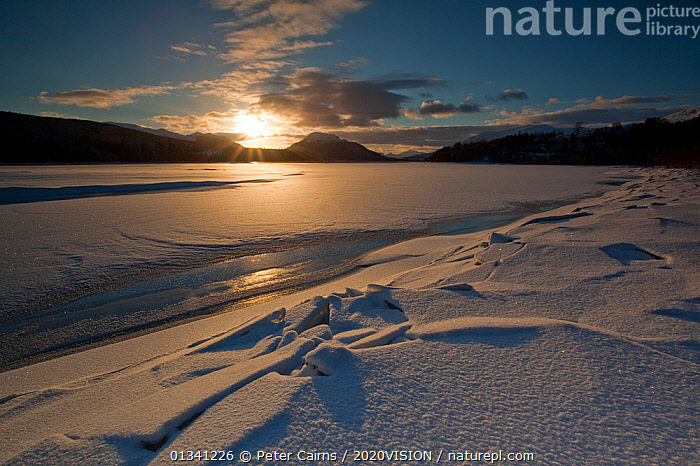 Sunset over Loch Laggan with snow and ice, Creag Meagaidh NNR, Highland, Scotland, UK, December 2010, 2020VISION,ATMOSPHERIC,EUROPE,ICE,LAKES,LANDSCAPES,MOUNTAINS,PCA_3_0161210_24,SCOTLAND,SNOW,SUN,SUNSET,UK,WINTER,United Kingdom, Peter Cairns / 2020VISION