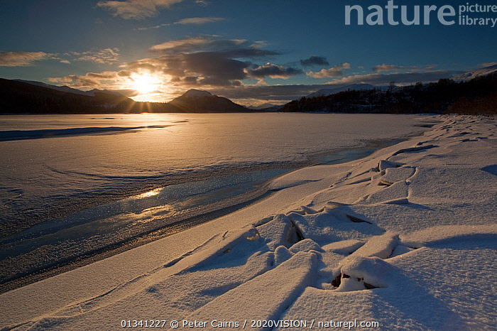 Sunset over Loch Laggan with snow and ice, Creag Meagaidh NNR, Highland, Scotland, UK, December 2010, 2020VISION,ATMOSPHERIC,EUROPE,ICE,LAKES,LANDSCAPES,MOUNTAINS,PCA_3_0161210_25,SCOTLAND,SNOW,SUN,SUNSET,UK,WINTER,United Kingdom, Peter Cairns / 2020VISION