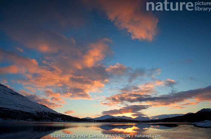 """Sunset over Loch Laggan, Creag Meagaidh NNR, Highland, Scotland, UK, December 2010. Photographer quote: """"I�ve got to admit I wasn�t happy after a fruitless flat grey day in the hills. And then, as if by magic, the sky lit up just long enough for me to grab a few shots. Loch Laggan sits at the foot of Creag Meagaidh a huge woodland restoration project in the Scottish Highlands."""" Did you know? Creag Meagaidh translates as �the bogland rock�. Today it is a changing landscape with extensive areas of birch woodland returning after decades of over grazing., PICDAY,2020VISION,ATMOSPHERIC,EUROPE,LAKES,LANDSCAPES,MOUNTAINS,PCA_3_0161210_37,REFLECTIONS,RESERVE,SCOTLAND,SKY,SUNSET,UK,WATER,WINTER,United Kingdom, Peter Cairns / 2020VISION"""