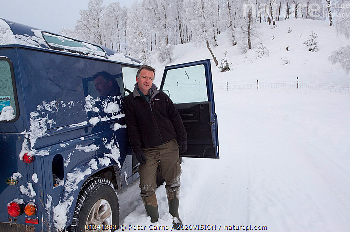 Pete Cairns, photographer, beside four-wheel drive vehicle in Silver birch (Betula pendula) woodland in winter, Glenfeshie, Cairngorms NP, Highlands, Scotland, UK, December 2010, 2020VISION,BROADLEAF,CAIRNGORMS,CALEDONIAN PINEWOODS,EUROPE,FORESTS,FROST,LANDSCAPES,MAN,NATIONAL,OUTDOORS,PARK,PCA_14_281210_63,PEOPLE,SCOTLAND,SNOW,UK,VEHICLES,WHITE,WINTER,Weather,United Kingdom, Peter Cairns / 2020VISION