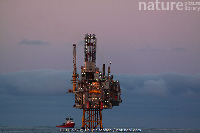 """""""Oseberg Ost"""" production platform at dusk, North Sea, June 2011.  ,  ATMOSPHERIC,BOATS,EUROPE,FUEL,INDUSTRY,LIGHTS,NORTH SEA,OIL,OILRIG,OIL RIG,OILRIGS,OIL RIGS,SKIES,SUPPORT BOATS,WORKING BOATS  ,  Philip Stephen"""