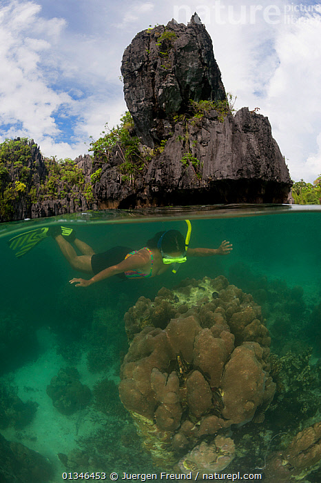 Snorkeler swimming over coral reef, split level.  Palawan, Philippines, May 2009.  ,  ASIA,CORAL TRIANGLE,CORAL REEFS,INDO PACIFIC,MARINE,PEOPLE,ROCKS,SNORKELING,SPLIT LEVEL,TROPICAL,UNDERWATER,VERTICAL,,SOUTH-EAST-ASIA  ,  Jurgen Freund