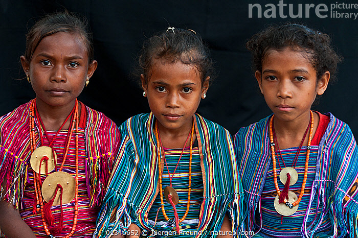Portrait of three young East Timorese girls in traditional clothing, Maubara, East Timor, August 2010.  ,  ASIAN,CHILD,CHILDREN,CORAL TRIANGLE,GIRLS,INDO PACIFIC,PEOPLE,PORTRAITS,SOUTH EAST ASIA,THREE,  ,  Jurgen Freund