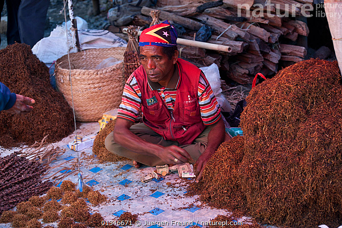 Market vendor sells loose tobacco, Maubisse, East Timor, August 2010..  ,  CORAL TRIANGLE,CROPS,INDO PACIFIC,MAN,MARKET,PEOPLE,SOUTH EAST ASIA,TRADE,  ,  Jurgen Freund