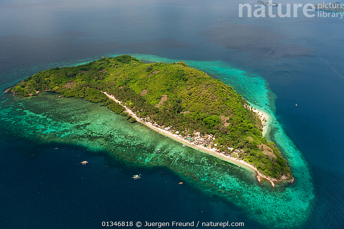 Aerial view of coastal island community with outrigger boats and white sandy beaches, Palawan, Philippines, May 2009.  ,  AERIALS,BEACHES,BOATS,CORAL TRIANGLE,INDO PACIFIC,ISLANDS,LANDSCAPES,PHILIPPINES,SOUTH EAST ASIA,TROPICAL,,SOUTH-EAST-ASIA,Asia  ,  Jurgen Freund