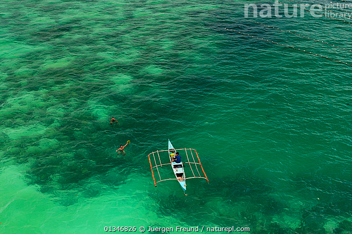 Aerial view of farmers on outrigger boat working at a seaweed farm growing agar-agar for processing into carageenan (gelatinous extracts used as binder for food or product) Philippines, May 2009.  ,  AERIALS,ALGAE,BOATS,CANOES,COMMERCIAL,CORAL TRIANGLE,DUGOUTS,GREEN,INDO PACIFIC,LANDSCAPES,OUTRIGGERS,PEOPLE,PHILIPPINES,SEAWEED,SOUTH EAST ASIA,TRADITIONAL,WORKING,,Plants,OPEN-BOATS,SOUTH-EAST-ASIA,Asia  ,  Jurgen Freund