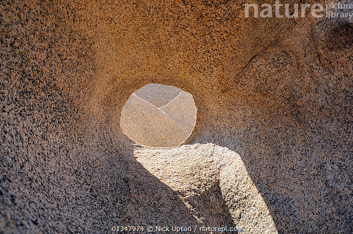 """Porthole"" window carved through granite rocks by wind, weather and sea erosion. Campomoro Point, near Propriano, Corsica, France, June 2010., CORSICA,EROSION,EUROPE,FRANCE,GEOLOGY,LANDSCAPES,MEDITERRANEAN,ROCK FORMATIONS,ROCKS, Nick Upton"
