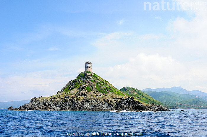 Tour de la Pirata, a 17th Century Genoese watchtower on Punta de la Pirata. Near Ajaccio, Corsica, France, May 2010., BUILDINGS,COASTS,CORSICA,EUROPE,FRANCE,HISTORIC,LANDSCAPES,MEDITERRANEAN,MOUNTAINS,SEASCAPES, Nick Upton