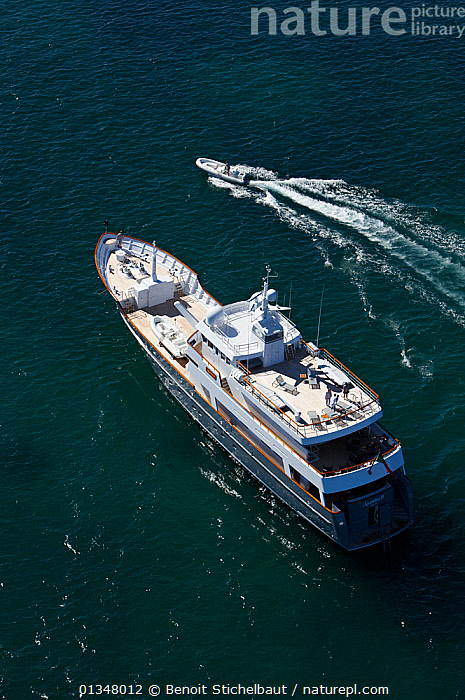 """Aerial image of superyacht """"Axantha II"""" with tender alongside, Brittany, France, June 2011. All non-editorial uses must be cleared individually., AERIALS,BOATS,DECKS ,EUROPE,LUXURY,MIXED BOATS,MOTORBOATS,SCALE,SIZE,SUPERYACHTS,TENDERS,VERTICAL,WAKE,BOAT-PARTS,OPEN-BOATS  ,core collection xtwox, Benoit Stichelbaut"""