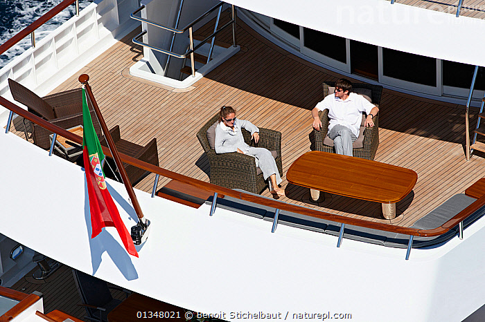 """Couple relaxing on board superyacht """"Axantha II"""", Brittany, France, June 2011. All non-editorial uses must be cleared individually., BOATS,COUPLES,DECKS ,FLAGS,HIGH ANGLE SHOT,HOLIDAYS,LARGE,LEISURE,LIFESTYLE,LUXURY,MAN,MOTORBOATS,MS,PEOPLE,RELAXATION,STERNS,SUPERYACHTS,WOMAN,BOAT-PARTS,Europe,SIZE, Benoit Stichelbaut"""