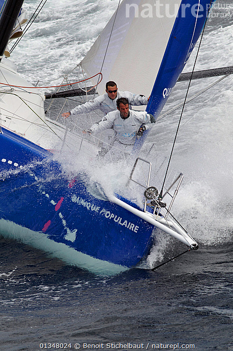 """Wet crew on the bow of monohull """"Banque Populaire"""" during training ahead of Transat Jacques Vabre 2011. Lorient, Brittany, France, July 2011. All non-editorial uses must be cleared individually.  ,  ACTION,BOATS,BOWS,CHOPPY,CREWS,EUROPE,EXTREME,HIGH ANGLE SHOT,MEN,MS,NOSE DIVING,OPEN 60,PEOPLE,RACES,SAILING BOATS,SPRAY,VERTICAL,WET,YACHTS,BOAT-PARTS,SAILING-BOATS,core collection xtwox  ,  Benoit Stichelbaut"""